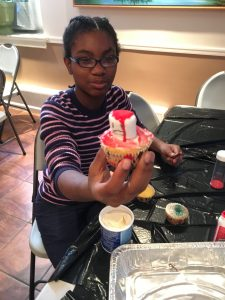 Aniyah shows off her creation