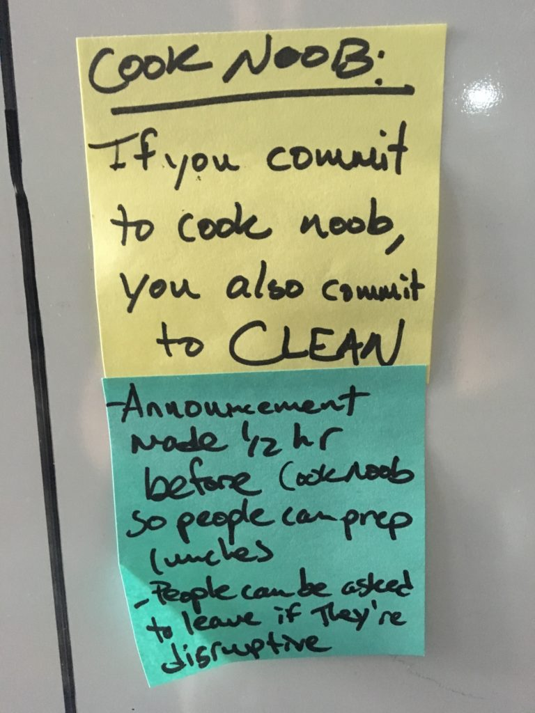 "two post-it notes, one yellow and one blue, that read ""Cook Noob: if you commit to cook noob, you also commit to CLEAN. Announcement half hour before cook noob so people can prep lunches. People can be asked to leave if they're disruptive."""